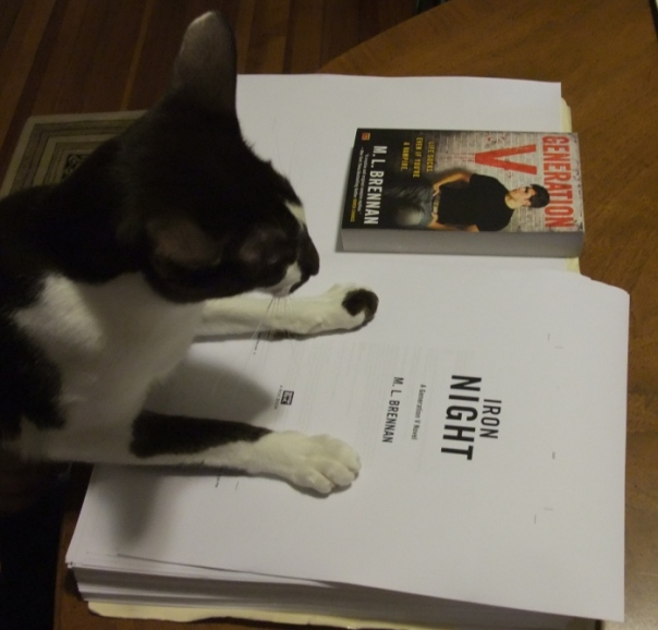 "The author's cat proudly surveys the page proofs. ""Yes,"" she thinks. ""Right here is where I will vomit tonight."""