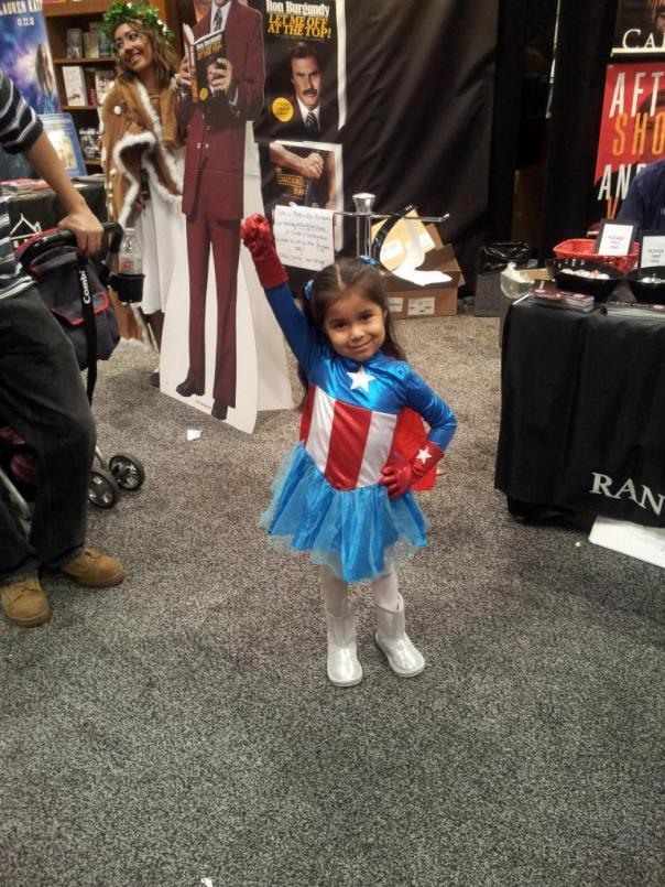 My favorite cosplay at the con. Look how adorable she is! And as soon as her mom gave us permission to take pictures, that was exactly the pose she struck. Loved it. Photo generously provided by Richard Shealy, SFWA-registered copyeditor.