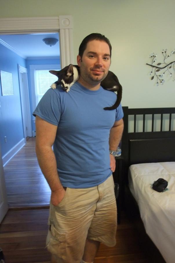 Tuxie on Adam's shoulders